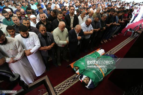 Palestinians perform the funeral prayer behind the dead bodies of Ahmed Ibrahim Zaki alTaweel and Ahmad Ahmad Abu Naim who were killed after Israeli...