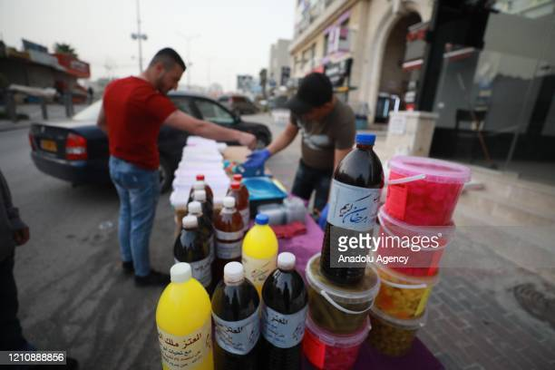 Palestinians prepare pickles and juice for Muslim's holy month Ramadan under the coronavirus precautions taken in Ramallah, West Bank on April 24,...