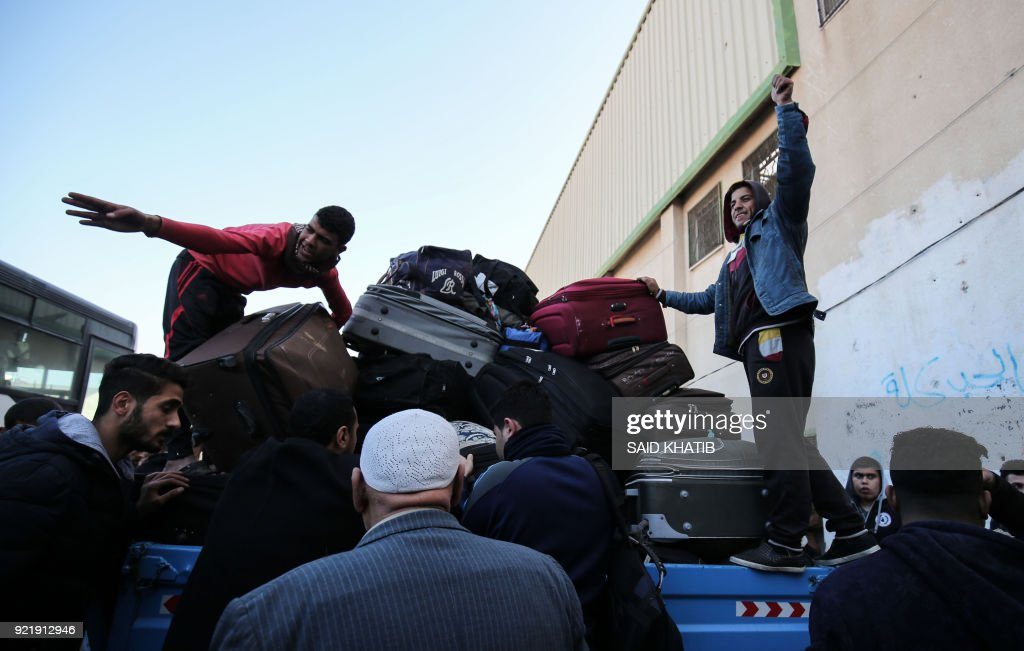 Palestinians prepare to cross into Egypt through the Rafah border crossing in the southern Gaza Strip after it was opened by Egyptian authorities on February 21, 2018. Both Israel and Egypt have maintained blockades of Gaza for years, arguing that they are necessary to isolate Hamas. /