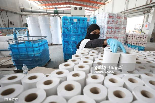 Palestinians produce paper napkins from Palm wastes in Jericho West Bank on October 18 2019 Palm wastes are turned into pulp without leaving liquid...