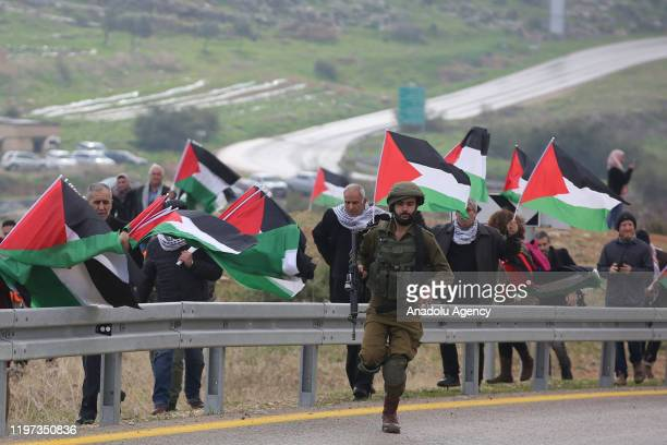 Palestinians protest against US President Donald Trump's peace plan in Jordan Valley West Bank on January 29 2020