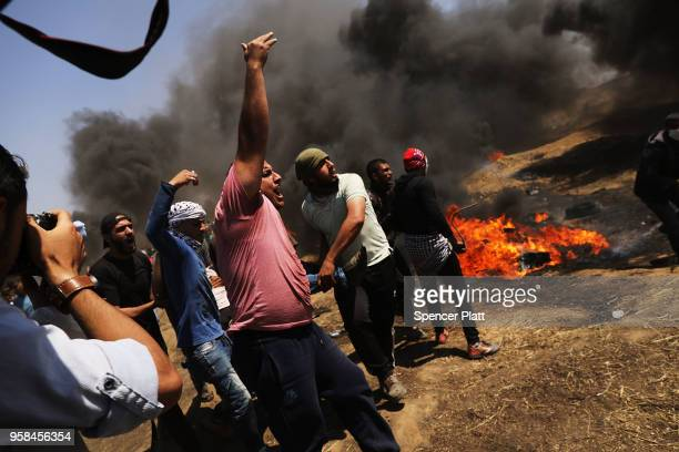 Palestinians protest at the border fence with Israel as mass demonstrations continue on May 14 2018 in Gaza City Gaza Israeli soldiers killed at...