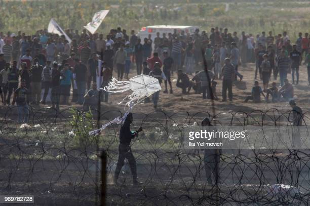 Palestinians protest by the IsraelGaza border during long day of clashes with Israeli troops on June 8 2018 in near Nahal Oz Israel Naksa is Arabic...