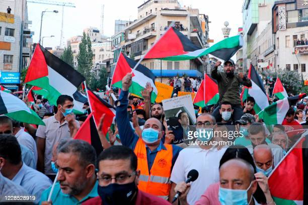 Palestinians protest in Ramallah in the occupied West Bank against Israeli normalisation deals with the United Arab Emirates and Bahrain on September...