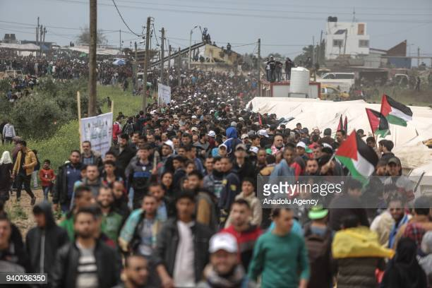 Palestinians rally during the 'Great Return March' in Gaza City Gaza on March 30 2018 Dubbed the Great Return March Fridays rallies in the Gaza Strip...