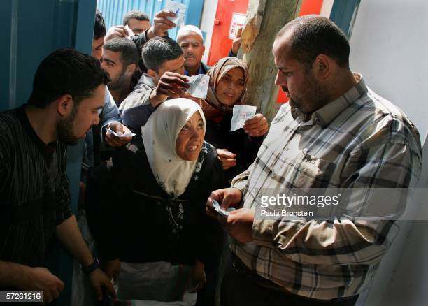 Palestinians reach out for World Food Program food handouts of cooking oil macaroni and halal meet during distribution April 5 2006 in Gaza City the...