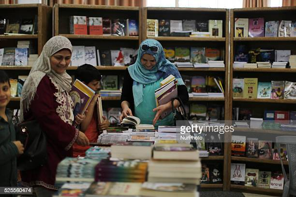 Palestinians read books at a Book Fair that kicked off at Christian Youth Association in Gaza City, on April 28, 2016. The book fair was held to...