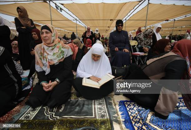 Palestinians read the Quran before performing second Friday Prayer of Islamic holy month of Ramadan at the AlAqsa Mosque after Israeli authorities'...