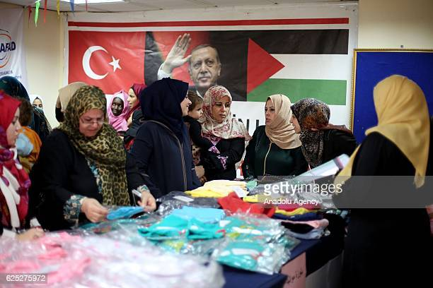 Palestinians receives Turkish humanitarian aid in Gaza City Gaza on November 23 2016 On July 3 The Turkish aid ship 'Lady Leyla' and ''Eclips''...