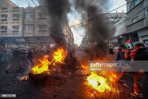 Palestinians refugees attend a protest against the US President decision to recognize Jerusalem as the capital of Israel in Jabaliya refugee camp...