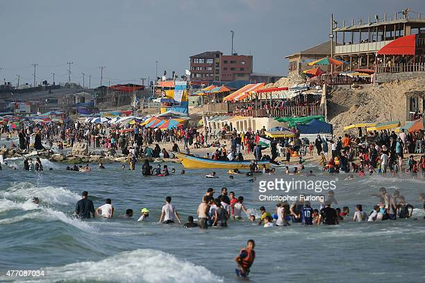 Palestinians relax and spend leisure time on Gaza Beach on June 13 2015 in Gaza City Gaza Palestinians are taking the opportunity to relax and enjoy...