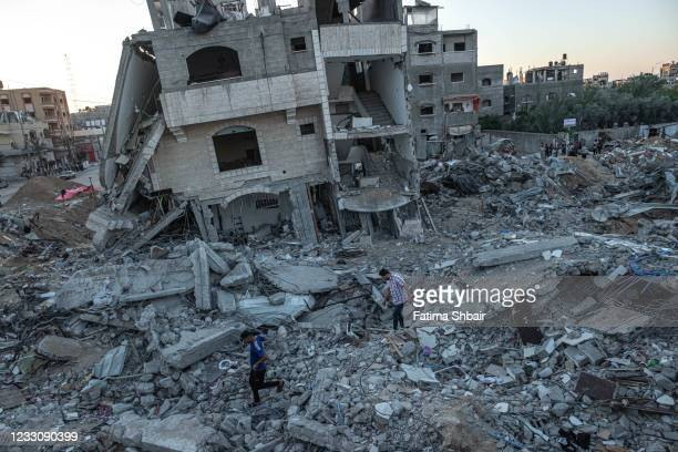 Palestinians resume life amid the rubble of their destroyed homes on May 24, 2021 in Beit Lahia, Gaza. Gaza residents continue clean up operations as...