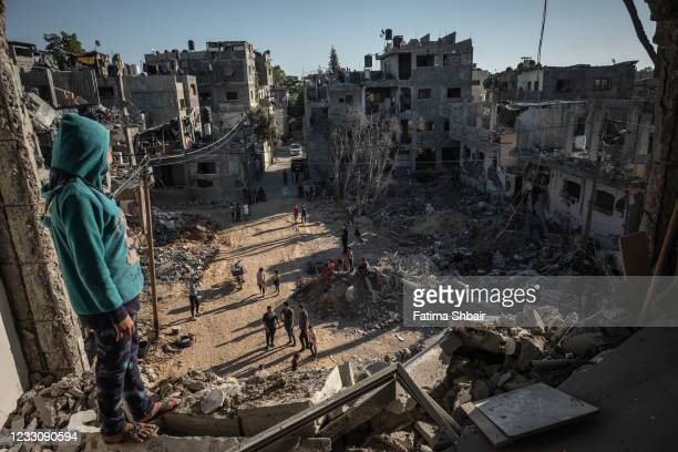 Palestinians return to the rubble of their destroyed homes on May 24, 2021 in Beit Hanoun, Gaza. Gaza residents continue clean up operations as they...