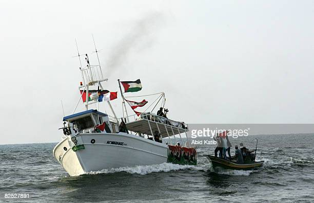 Palestinians ride a fishing boat as they greet the USbased Free Gaza protest group on one of two boats upon its arrival from Cyprus August 23 2008 in...