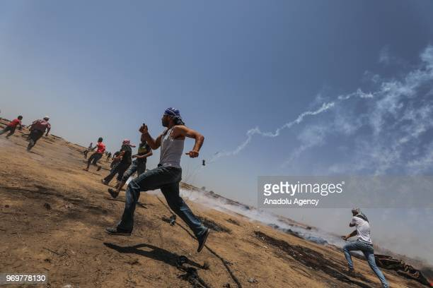 Palestinians run away after Israeli forces fired tear gas during the protests called commemorating the Naksa along the border fence east of Khan...