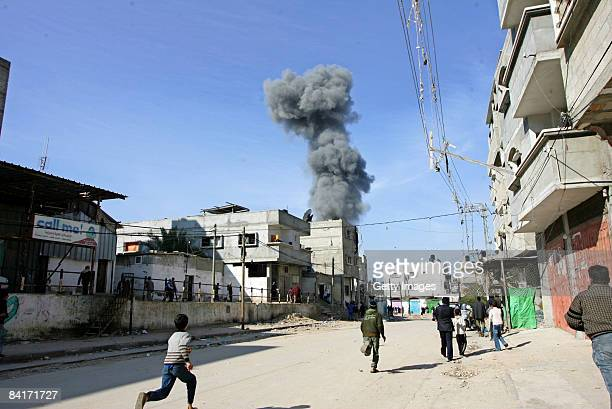 Palestinians run towards the location of an Israeli airstrike on January 5 2009 in Rafah southern Gaza Israel is intensifying its widescale ground...