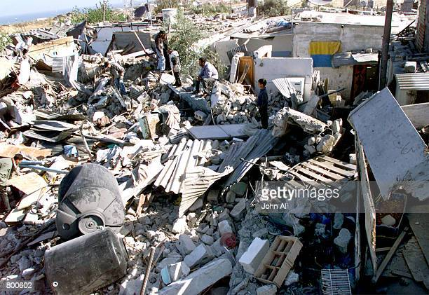 Palestinians search for their belongings in the rubble of their ravaged homes in Khan Yunis Refugee camp in southern Gaza Strip April 11 2001 In a...