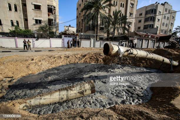 Palestinians seen at the site of Israeli air strikes in in Jabaliya refugee camp. Israel and the Palestinians are mired in their worst conflict in...