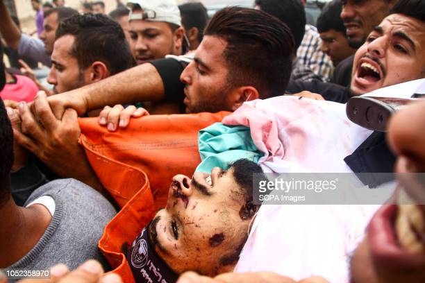 Palestinians seen carrying the body of Naji alZa'anin during his funeral Naji Jamal alZa'anin 25 years old was killed by an Israeli airstrike in the...