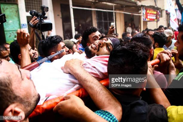Palestinians seen carrying the body of Naji al-Za'anin during his funeral. Naji Jamal al-Za'anin, 25 years old was killed by an Israeli airstrike in...