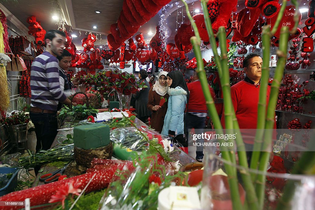 Palestinians shop at a flower market on Valentine's Day in Gaza City on February 14, 2013. Valentine's Day is increasingly popular in the region as people have taken up the custom of giving flowers, cards, chocolates and gifts to sweethearts to celebrate the occasion.