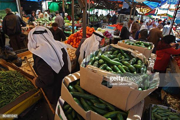 Palestinians shop for fresh produce in the local fruit and vegetable market April 2 2008 in the West Bank city of Ramallah World food prices are...