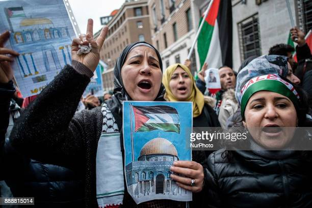 Palestinians shout slogans and wave flags in front of the US Embassy as they held a demonstration against the US president's Donald Trump recognition...
