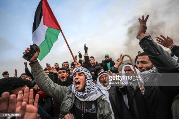 Palestinians shout slogans as Israeli forces intervene protestors during a Great March of Return demonstration at Huzaa district of Khan Yunis Gaza...