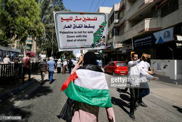 Palestinians shout slogans during a protest against the United Arab Emirates' deal with Israel to normalise relations, in Gaza City, on August 19,...