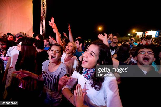 Palestinians sing and dance during a Boney M perform on July 20 2010 in Ramallah WestBank