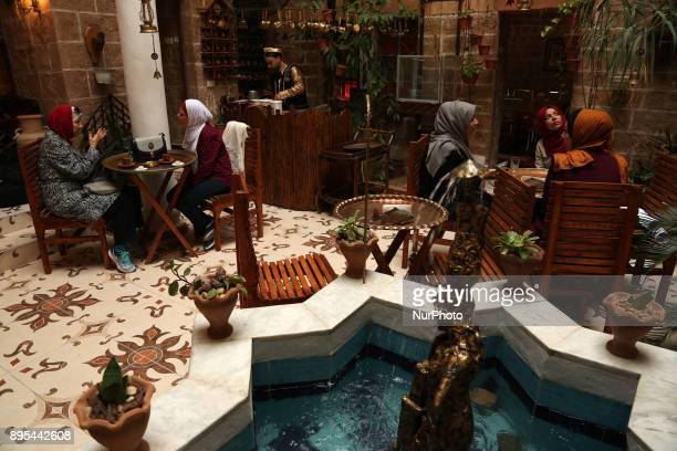 Palestinians sit in at the ''Bait Sitty resturant'' in the Old Gaza city on December 19 2017 Bait Sitty resturant is the first archaeological...
