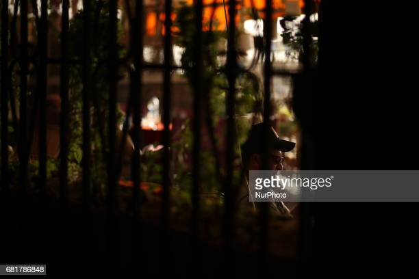 Palestinians smoke shisha or hookah at a coffee shop in Gaza City on May 11 2017