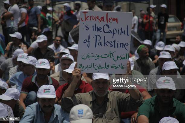 Palestinians stage a demonstration to protest metal detectors installed by Israeli authorities to AlAqsa Mosque Compund after performing Friday...