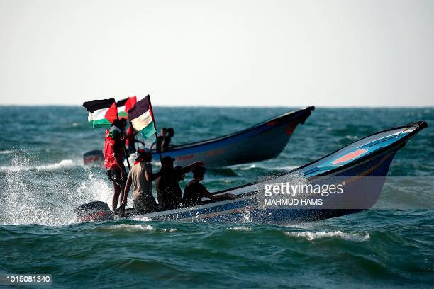 TOPSHOT Palestinians steer their boat as they protest against the more than a decadelong Israel's naval blockade of Gaza in Beit Lahya on the border...
