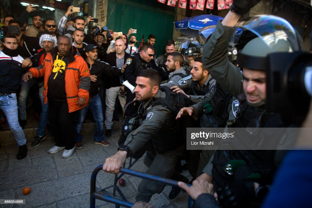 Palestinians struggle with Israeli police at the Old City after Friday prayer on December 8, 2017 in Jerusalem, Israel. At least 50 Palestinians have been wounded in clashes between Palestinian protestors and Israeli security forces in the West Bank and the Gaza Strip on Friday after thousands of protestors took to the streets in a second 'Day of Rage' following U.S. President Donald Trump's decision to recognize Jerusalem as Israel's capital on Wednesday.