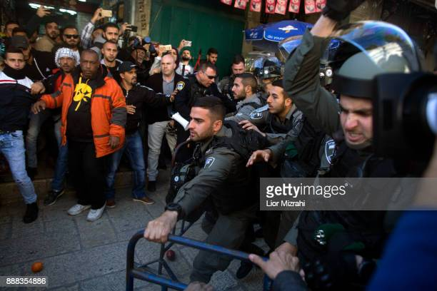 Palestinians struggle with Israeli police at the Old City after Friday prayer on December 8 2017 in Jerusalem Israel At least 50 Palestinians have...