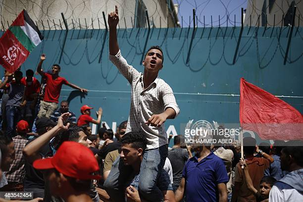 Palestinians supporting the Popular Front for the Liberation of Palestine take part in a protest against the reduction of educational programs given...