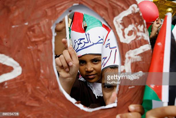 Palestinians take part at a protest organized to mark the 66th anniversary of Nakba, and to condemn the international silence towards the rights of...