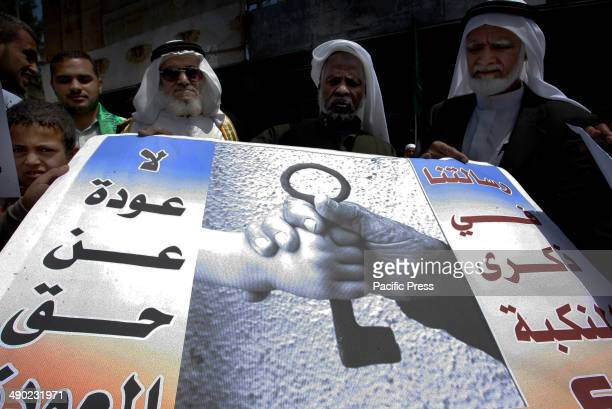 "Palestinians take part during a rally marking the ""Nakba"" in Rafah town in the southern Gaza Strip. Nakba means in Arabic ""catastrophe"" in reference..."