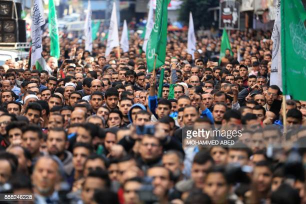 TOPSHOT Palestinians take part in a Hamas rally in the Gaza Strip's Jabalia refugee camp on December 8 against US President Donald Trump's decision...