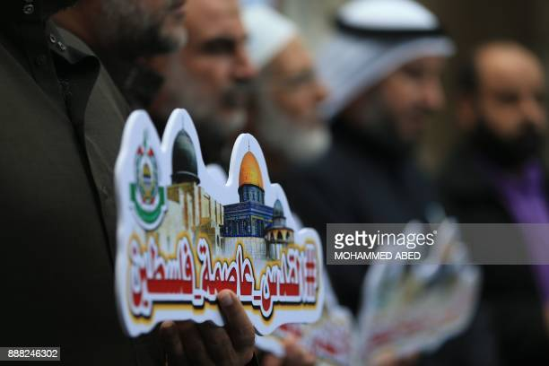 Palestinians take part in a Hamas rally in the Gaza Strip's Jabalia refugee camp on December 8 against US President Donald Trump's decision to...