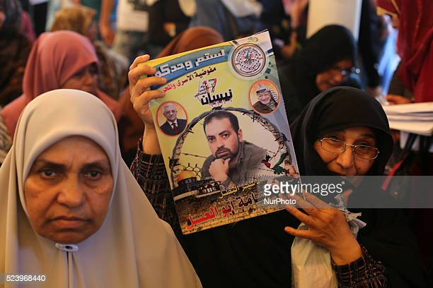 Palestinians take part in a protest demanding release the prisoners in Israeli jails in front of Red cross office in Gaza city on April 25 2016