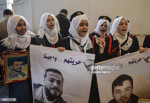 Palestinians take part in a protest demanding the release of Israeliheld Palestinian prisoners in front of the International Red Cross building in...
