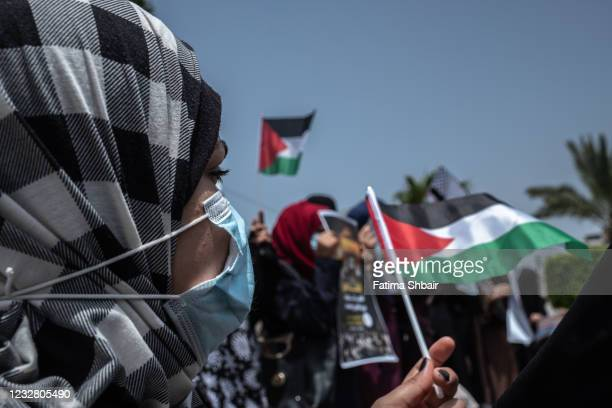 Palestinians take part in a prtoest in solidarity with the Al-Aqsa Mosque, on May 10, 2021 in Gaza City, Gaza. Tensions have risen in Jerusalem over...