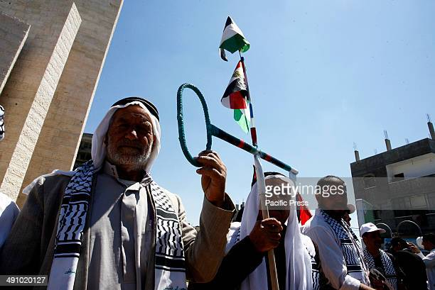 """Palestinians take part in a rally ahead of the 66th anniversary of Nakba, in Rafah in the southern Gaza Strip. Palestinians will mark """"Nakba"""" on May..."""