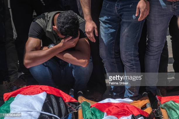 Palestinians take part in the funeral of the Abu Hatab family in Gaza City on May 15, 2021 in Gaza City, Gaza. More than 125 people in Gaza and eight...