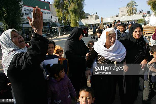 Palestinians take shelter at a United Nations aid centre situated in a school on January 5 2009 in Rafah southern Gaza Israel is intensifying its...
