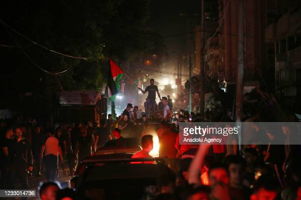 """Palestinians take the streets after """"mutual and simultaneous"""" cease-fire deal between Israel and Hamas reached with Egypt mediation took effect at 2..."""