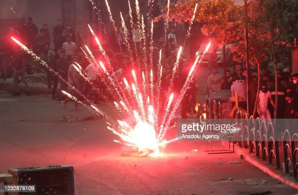Palestinians throw fireworks against Israeli forces' with tear gas canisters, plastic and real bullets interventions during a protest against Israeli...