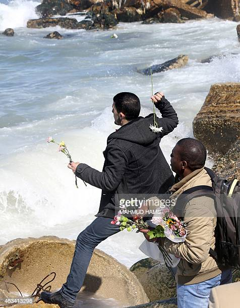 Palestinians throw flowers into the sea in Gaza City on February 14 in remembrance of the three victims of the Chapel Hill shooting in the US More...